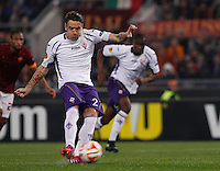 Calcio, Europa League: Ritorno degli ottavi di finale Roma vs Fiorentina. Roma, stadio Olimpico, 19 marzo 2015.<br /> Fiorentina's Gonzalo Rodriguez scores on a penalty kick during the Europa League round of 16 second leg football match between Roma and Fiorentina at Rome's Olympic stadium, 19 March 2015.<br /> UPDATE IMAGES PRESS/Isabella Bonotto