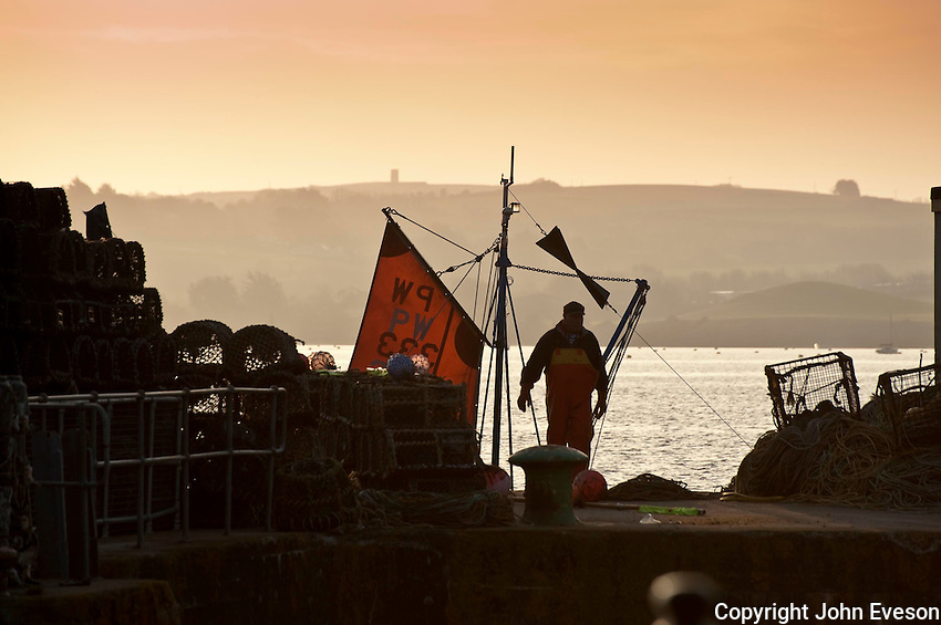 Fisherman preparing to go to sea at Padstow, Cornwall