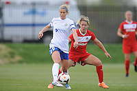 Boyds MD - April 19, 2014: Jen Buczkowski (6) of FC Kansas City shields the ball from Lori Lindsey (6) of the Washington Spirit. The Washington Spirit defeated the FC Kansas City 3-1 during a regular game of the 2014 season of the National Women's Soccer League at the Maryland SoccerPlex.