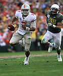 Ohio State quarterback Terrelle Pryor sprints past Oregon's Kenny Rowe in the 96th Rose Bowl in Pasadena, Ca. January 1, 2010.
