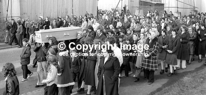 Mourners carry the coffin of 13 year old schoolboy Brian Stewart who was fatally injured by a rubber bullet in disputed circumstances and died in hospital on 4th October 1976. The army claimed they were under attack from stone-throwers. Local people contested this saying there was no rioting. The subsequent inquest decided Brian Stewart had been rioting and a later claim for compensation in the European Court of Human Rights was unsuccessful. Brian Stewart was from Norglen Crescent, Turf Lodge, Belfast, N Ireland. 197610070436<br /> <br /> Copyright Image from Victor Patterson, 54 Dorchester Park, Belfast, UK, BT9 6RJ<br /> <br /> Tel: +44 28 9066 1296<br /> Mob: +44 7802 353836<br /> Voicemail +44 20 8816 7153<br /> Email: victorpatterson@me.com<br /> Email: victorpatterson@gmail.com<br /> <br /> IMPORTANT: My Terms and Conditions of Business are at www.victorpatterson.com