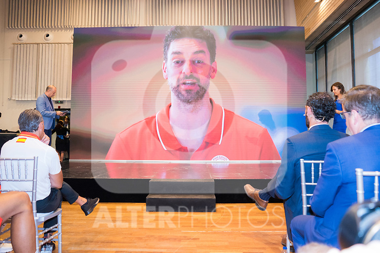 Coach Sergio Scariolo (l) and president Jorge Garbajosa (r) watch a Pau Gasol's video message during the official presentation of Spanish National Team of Basketball.  July 24, 2019. (ALTERPHOTOS/Francis Gonzalez)