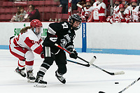 BOSTON, MA - JANUARY 11: Avery Fransoo #27 of Providence College takes a shot as Julia Nearis #15 of Boston University defends during a game between Providence College and Boston University at Walter Brown Arena on January 11, 2020 in Boston, Massachusetts.