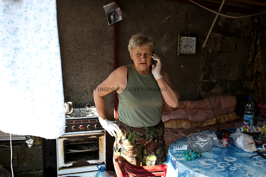 UKRAINE, Pisky: Evdokiya Polovich alias Mama in the brigade 93 as a medic. She joined the army as she felt that she will be useful as a medic. Since then, she does a shift of one month in Pisky  then 2 weeks off at home. She's responsible of the first aid and to arrange the transport of injured soldiers to the nearest hospital. <br /> <br /> UKRAINE, Pisky: Evdokiya Polovich alias Mama fait partie de la brigade 93 en tant que m&eacute;decin. Elle a rejoint l'arm&eacute;e car elle sentait qu'elle serait utile en tant que m&eacute;decin. Depuis lors, elle fait un shift d'un mois &agrave; Pisky puis 2 semaines de repos &agrave; la maison. Elle est responsable des premiers soins et d'organiser le transport des soldats bless&eacute;s &agrave; l'h&ocirc;pital le plus proche.