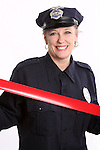 A woman security guard with red tape