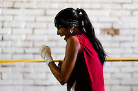 Geraldin Hamann, a young Colombian boxer, practices shadowboxing while training in the boxing gym in Cali, Colombia, 27 June 2013. During the recent years, Kina Malpartida, a Peruvian female professional boxer, has won the World Championship title several times and so she has become a sporting idol and an inspiration for a generation of young girls throughout Latin America. Working out hard in poorly equipped gyms, they dream of becoming a boxing star. The Cauca Valley and the Caribbean coast are believed to be a home of the most talented female boxers in Colombia.