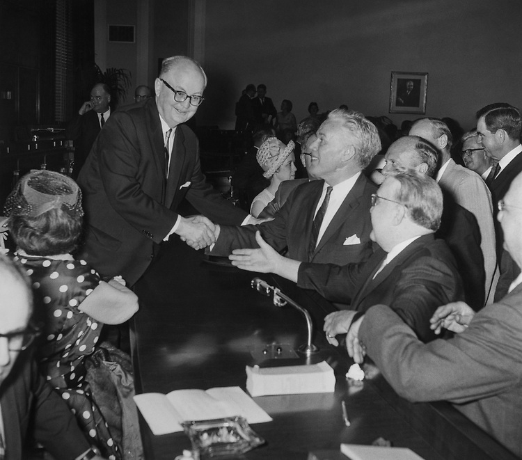Rep. Wright Patman, D-Tex., the Chairman of Banking and Currency is congratulated by Rep. William B. Widnall, R-N.J., Ranking Member on Banking and Currency. 1965 (Photo by Mickey Senko/CQ Roll Call)