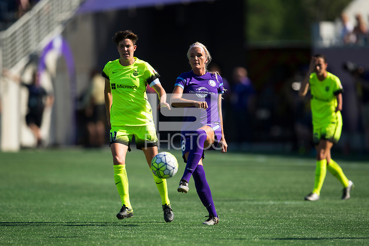 Orlando, FL - Sunday May 08, 2016: Orlando Pride midfielder Kaylyn Kyle (6) passes the ball under pressure from Seattle Reign FC midfielder Keelin Winters (11) during a regular season National Women's Soccer League (NWSL) match at Camping World Stadium.