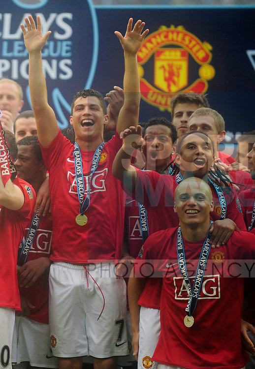 Manchester United's Cristiano Ronaldo, Nani, Anderson and Wes Brown celebrate winning the FA Premier League Trophy during the Premier League match at The JJB Stadium, Wigan. Picture date 11th May 2008. Picture credit should read: Simon Bellis/Sportimage