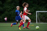 Seattle, WA - Thursday, May 26, 2016: Dominique Janssen (20) of Arsenal Ladies FC is marked by Seattle Reign FC midfielder Jessica Fishlock (10). The Seattle Reign FC of the National Women's Soccer League (NWSL) and the Arsenal Ladies FC of the Women's Super League (FA WSL) played to a 1-1 tie during an international friendly at Memorial Stadium.
