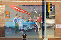 "A Route 66 Mural on the side of a auto repair shop depicts the former ""Mother Road"" that went through town, Joliet, IL"