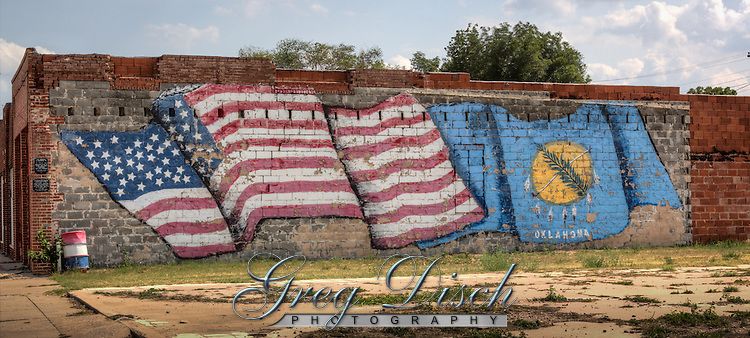 A mural on the side of the building next door to the Sandhills Curiosity Shop on Route 66 in Erick Oklahoma.