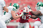 September 26, 2009: Michigan State Spartans offensive linemen Brendon Moss (64) and D.J. Young (59) battle Wisconsin Badgers defensive lineman Louis Nzegwu (93) during an NCAA football game at Camp Randall Stadium on September 26, 2009 in Madison, Wisconsin. The Badgers won 38-30. (Photo by David Stluka)