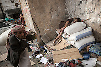 Monday 13 July, 2015: Workers are seen in a market place in the Old City of Sana'a, a 2,500-year-old cultural heritage site endangered after a fighter jet of the Saudi-led coalition bombed and destroyed a line of residential tower-houses killing 4 residents and reducing to rubble the historial site. The ongoing aerial campaign of bombardments by the Arab states and their western allies led by Saudi Arabia and the heavy fighting against the entrenchment of the Houthi insurgency along the Yemeni main cities from north to south has caused an international alert for the enlisted cultural heritage sites in Yemen, such as the historic town of Zabid, the Old City of Sana'a and the Old Walled City of Shibam. (Photo/Narciso Contreras)