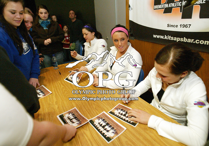 27 January 2010:  Washington Husky softball player Danielle Lawrie(center) enjoys a laugh with teammate (right) Alyson McWherter  and(left) Morgan Stuartm  while signing autographs.  Members for the Washington Softball team were on hand to give encouragement to students and community members on Wednesday at Olympic High School in Silvedrale, WA.