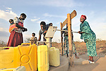 Women pump water from a well constructed by the United Methodist Committee on Relief (UMCOR) in the Southern Sudanese town of Yei. NOTE: In July 2011, Southern Sudan became the independent country of South Sudan