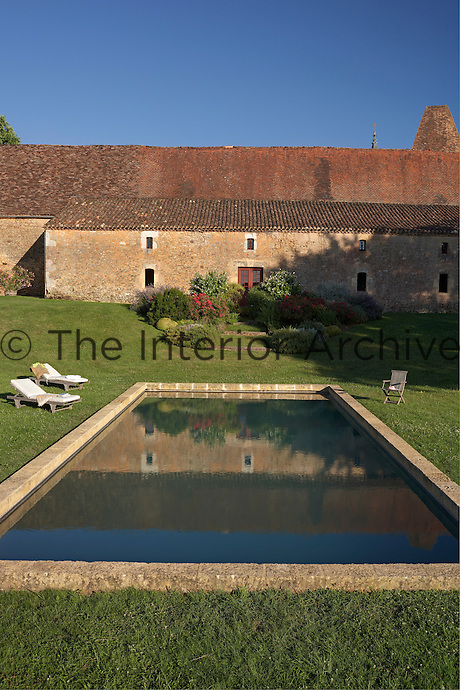 Swimming pool in front of the Pressoir building attached to the Chateau de la Bourlie, Dordogne