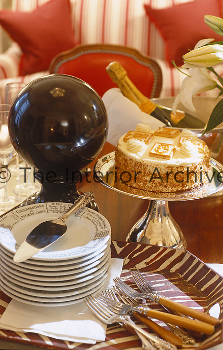 Champagne and cake on a table in the living room heralds a celebration