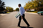 Republican congressional candidate Ricky Gill delivers a campaign sign to a supporter while canvassing in Stockton, Calif., September 18, 2012.