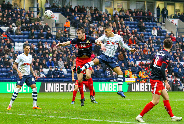 Preston North End's Graham Burke wins a header over Doncaster Rovers' Tom Anderson<br /> <br /> Photographer Alex Dodd/CameraSport<br /> <br /> The Emirates FA Cup Third Round - Preston North End v Doncaster Rovers - Sunday 6th January 2019 - Deepdale Stadium - Preston<br />  <br /> World Copyright &copy; 2019 CameraSport. All rights reserved. 43 Linden Ave. Countesthorpe. Leicester. England. LE8 5PG - Tel: +44 (0) 116 277 4147 - admin@camerasport.com - www.camerasport.com