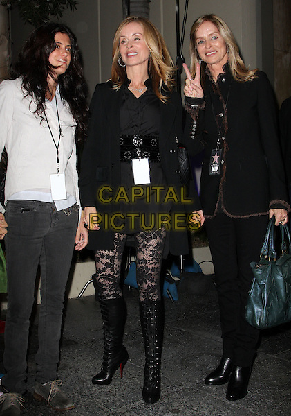 BARBARA BACH (left ) & guests.Ringo Starr Honored With A Star On The Hollywood Walk Of Fame held At On Hollywood Blvd., Hollywood, California, USA..February 8th, 2010.full length jacket dress skirt mini pattern tights boots green bag purse stars pattern print hand v peace sign .CAP/ADM/KB.©Kevan Brooks/AdMedia/Capital Pictures.