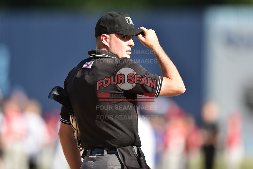 Home plate umpire Kyle Wallace starts the game as the only umpire in a game between the Charleston RiverDogs and the Asheville Tourists due to an injury earlier in the week to his crewmate  on June 13, 2015 in Asheville, North Carolina. The Tourists defeated the RiverDogs 10-6. (Tony Farlow/Four Seam Images)