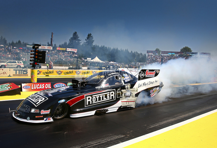 Aug. 3, 2014; Kent, WA, USA; NHRA funny car driver Tim Wilkerson during the Northwest Nationals at Pacific Raceways. Mandatory Credit: Mark J. Rebilas-