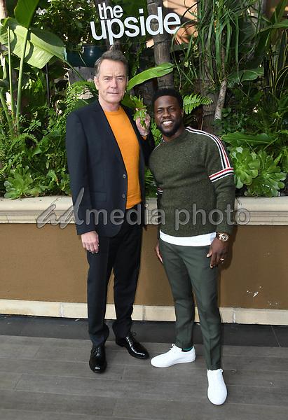 """30 October 2018 - Beverly Hills, California - Bryan Cranston, Kevin Hart. """"The Upside"""" Photo Call held at The Four Seasons at Beverly Hills . Photo Credit: Birdie Thompson/AdMedia"""
