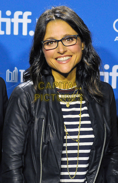 Julia Louis-Dreyfus<br /> &quot;Enough Said&quot; Press Conference, 2013 Toronto International Film Festival held at TIFF Bell Lightbox, Toronto, Ontario, Canada, <br /> 8th September 2013.<br /> portrait headshot glasses smiling gold necklaces  black striped white top leather jacket<br /> CAP/ADM/BPC<br /> &copy;Brent Perniac/AdMedia/Capital Pictures