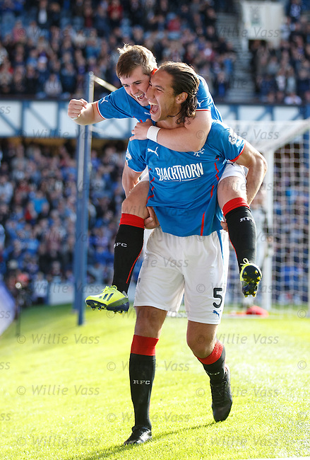 Bilel Mohsni celebrates with David Templeton after scoring for Rangers
