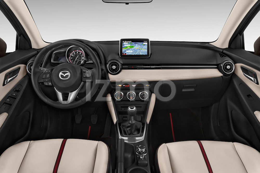 Stock photo of straight dashboard view of a 2015 Mazda Mazda2 Pulse Edition 5 Door Hatchback 2WD Dashboard