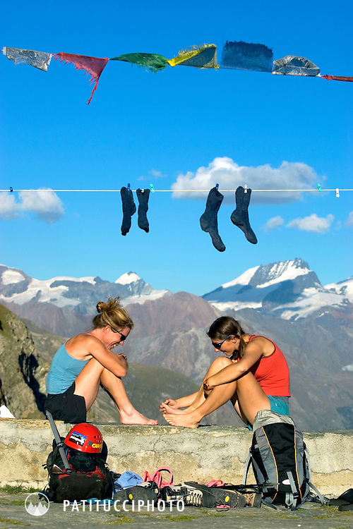 Chloe Lanthier and Janine Patitucci relaxing and chatting while on the deck of the Schonbiel Hut outside of Zermatt, Switzerland