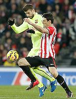 Atletic de Bilbao's Aritz Aduriz (r) and FC Barcelona's Gerard Pique during La Liga match.February 8,2015. (ALTERPHOTOS/Acero) /NORTEphoto.com