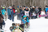 Michelle Phillips and team run past spectators on the bike/ski trail near University Lake with an Iditarider in the basket and a handler during the Anchorage, Alaska ceremonial start on Saturday, March 7 during the 2020 Iditarod race. Photo © 2020 by Ed Bennett/Bennett Images LLC