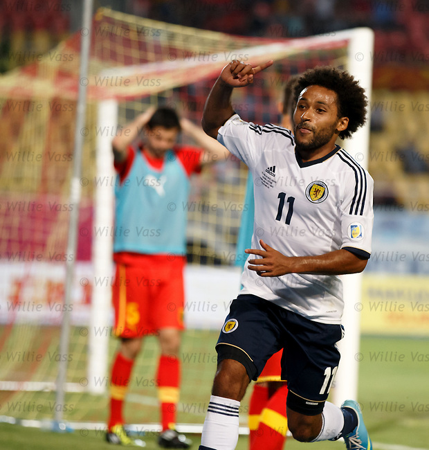 Ikechi Anya celebrates his goal for Scotland