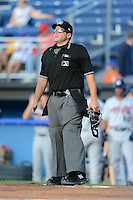Umpire Mike Savakinas during a NY-Penn League game between the Batavia Muckdogs and Tri-City ValleyCats on July 13, 2013 at Dwyer Stadium in Batavia, New York.  Tri-City defeated Batavia 5-4.  (Mike Janes/Four Seam Images)