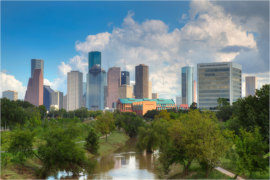 On a warm September afternoon, Houstonians get out and enjoy a relaxing stroll around the green belt that offers sweeping views ofthe Houston skyline and downtown. Featured as the tallest building in Houston, the JP Morgan Chase Tower rises 75 stories above the waterfront. <br />