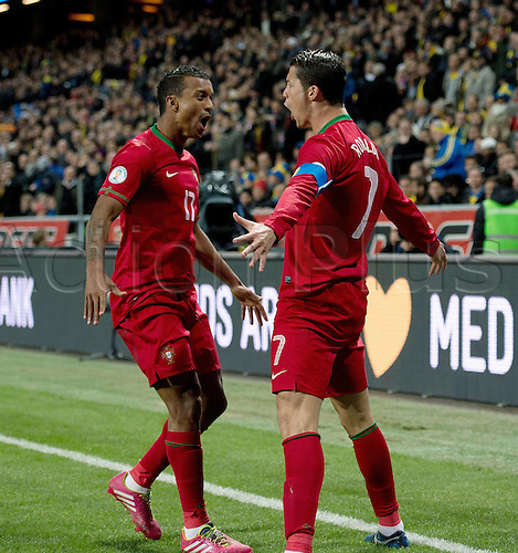 19.11.2013   World Cup Qualification 2014 Playoff in Stockholm Sweden - Portugal  Cristiano Ronaldo (re) and Nani celebrate their goal