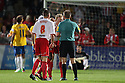 Stevenage players protest about Southampton's second goal with referee Oliver Langford. Stevenage v Southampton - Capital One Cup Second Round - Lamex Stadium, Stevenage - 28th August, 2012. © Kevin Coleman 2012