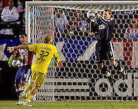 Chivas USA goalkeeper Dan Kennedy (1) leaps high for a save from advancing Columbus Crew forward Steven Lenhart (32). CD Chivas USA defeated the Columbus Crew 3-1 at Home Depot Center stadium in Carson, California on Saturday July 31, 2010.