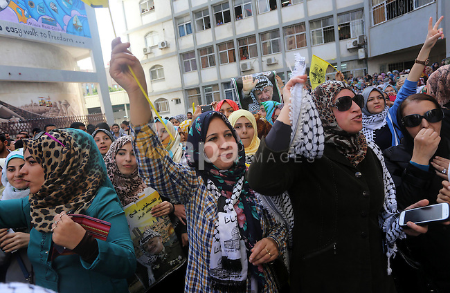 Supporters of the Palestinian Fatah movement shout slogans during a rally marking the tenth anniversary of late Palestinian leader and founder of the movement Yasser Arafat in front of the Al-Azhar University in Gaza City, on November 11, 2014. Photo by Mohammed Asad