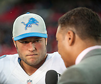 26.10.2014.  London, England.  NFL International Series. Atlanta Falcons versus Detroit Lions. Lions' QB Matthew Stafford [9] is interviewed after the game.