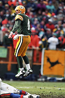 Green Bay Packer Quarterback Brett Favre leaps to see if his pass was complete in the December 8, 1996 game against the Denver Broncos. Favre threw for 4 touchdowns as the Pack won the contest 41-6.