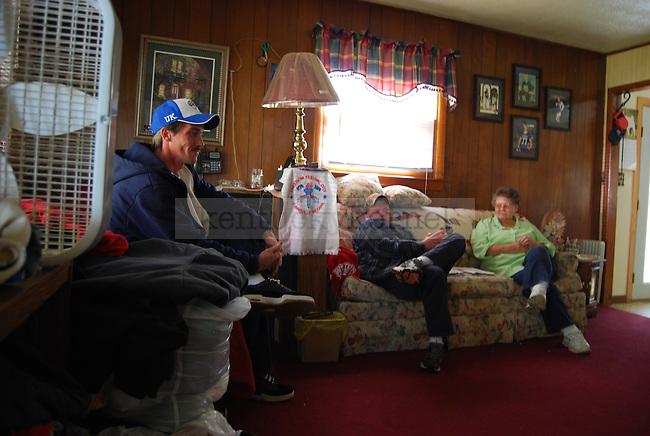 Arnold and Mike Gross with their mother Ernestine Gross, in her home near Quicksand, KY on October 13th, 2011. Photo by Lauryn Morris.