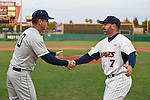 May 21, 2015; Stockton, CA, USA; BYU Cougars head coach Mike Littlewood (30, left) and Pepperdine Waves head coach Steve Rodriguez (7) during the WCC Baseball Championship at Banner Island Ballpark.