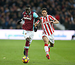 West Ham's Cheikhou Kouyate tussles with Stoke's Ramadan Sobhi during the Premier League match at the London Stadium, London. Picture date November 5th, 2016 Pic David Klein/Sportimage