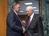 Charles P. Rettig, left, shakes hands with United States Senator Orrin Hatch (Republican of Utah), right, Chairman, US Senate Committee on Finance, before giving testimony on his nomination to be Commissioner Of Internal Revenue (IRS) on Capitol Hill in Washington, DC on Thursday, June 28, 2018.  Looking on from the center is US Senator Ben Carson (Democrat of Maryland).  Senator Hatch also serves as the president pro tempore of the Senate.<br /> Credit: Ron Sachs / CNP