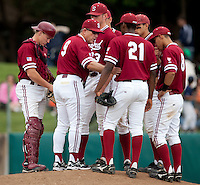 STANFORD, CA - April 23, 2011: Head coach Mark Marquess of Stanford baseball talks to the infield at the mound during Stanford's game against UCLA at Sunken Diamond. Stanford won 5-4.