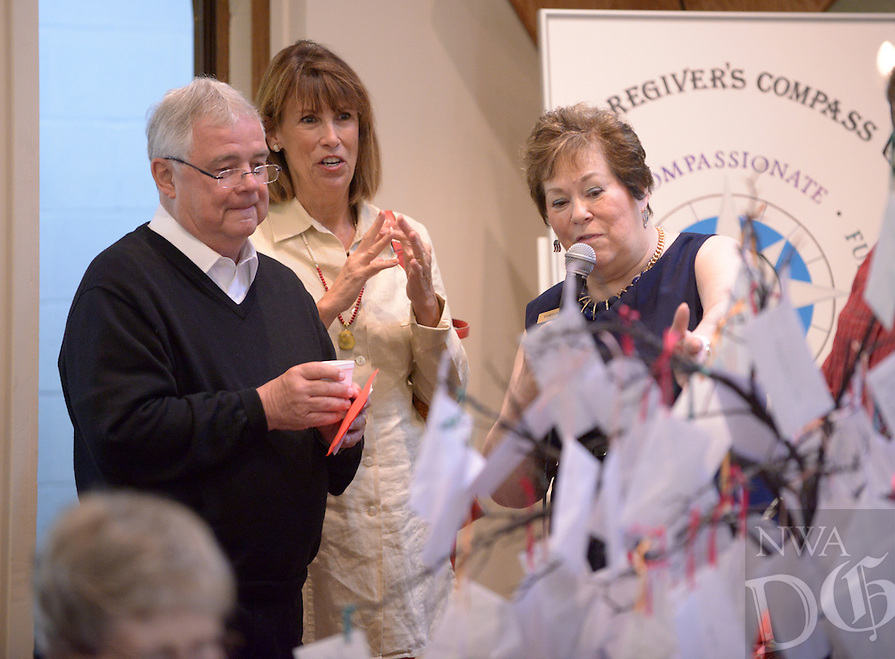 NWA Democrat-Gazette/BEN GOFF @NWABENGOFF<br /> Theda Hall (right) presents Pastor Fred Nelson and wife Robin Nelson with a 'vacation tree' of offerings from the congregation on Sunday May 29, 2016 during a retirement reception for Nelson at United Lutheran Church in Bella Vista. Nelson was the pastor of the church for over five years before stepping down in 2009 to serve as interim pastor for other congregations. Nelson served his last day in the pulpit at United Lutheran earlier in May after returning to serve as interim pastor for the congregation over the past 18 months.