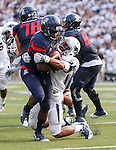 Nevada's Kendall Johnson tackles Arizona's Nick Wilson in an NCAA college football game in Reno, Nev., on Saturday, Sept. 12, 2015.(AP Photo/Cathleen Allison)